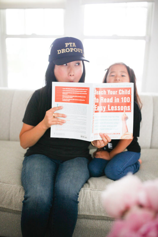 PTA Dropout, how to teach your child to read in 100 easy lessons, homeschooling kindergarten, homeschool, kindergarten, school at home, mommy and daughter, mother trucker hat, mommy and me
